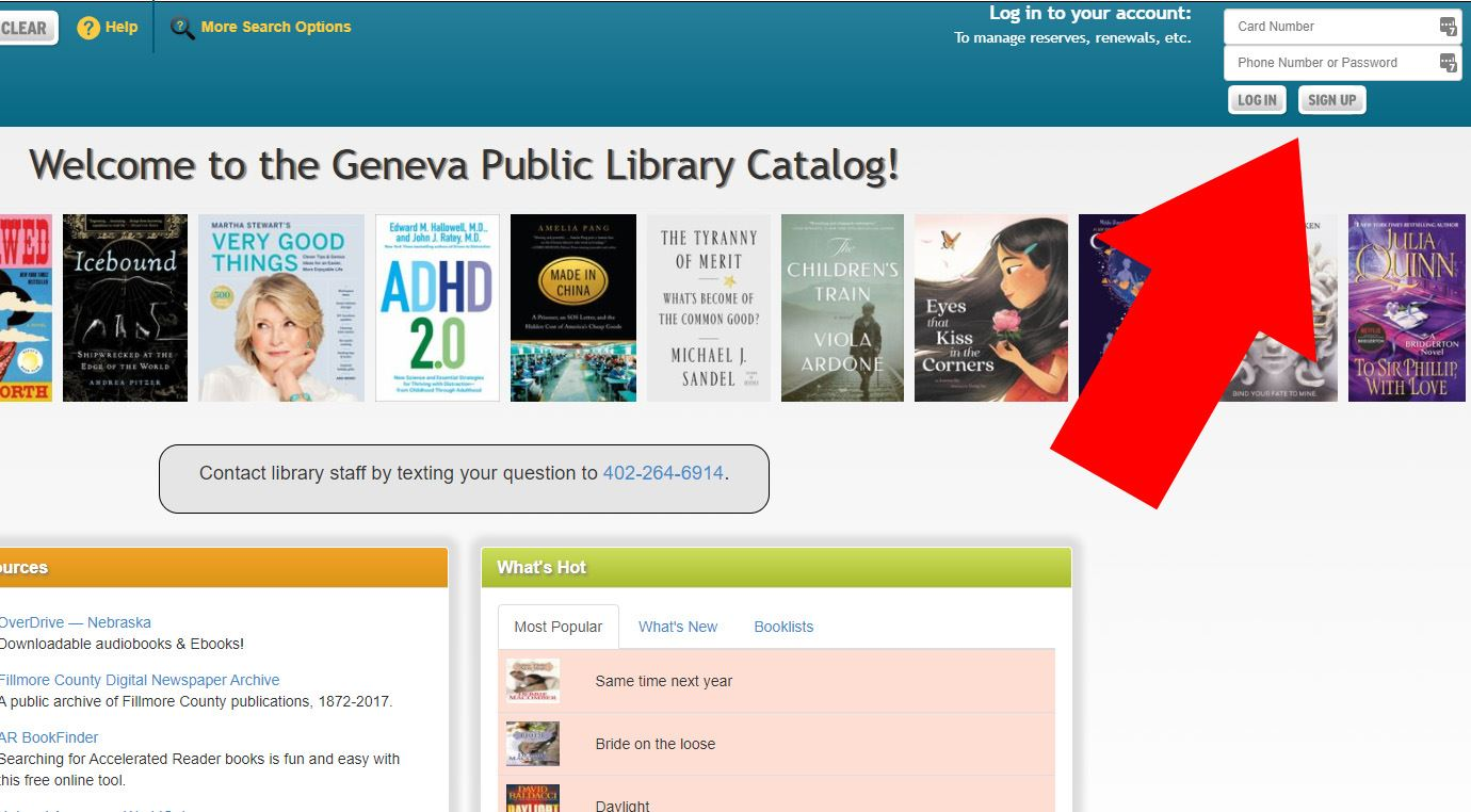 A picture of the library's catalog website with an arrow pointing to the Sign Up button.